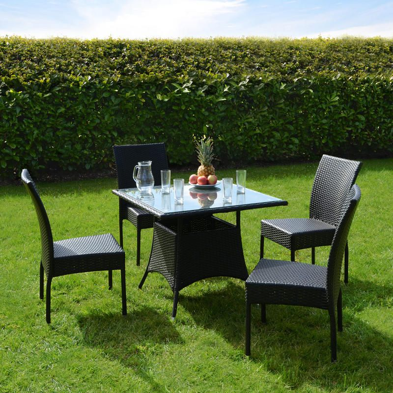 Garden furniture made of poly rattan brittany outdoor dining set with glass top table and four chairs. elegant QKVOGBI