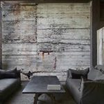 Concrete wall brings industrial chic in the interior