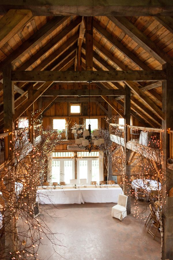 rustic country barn wedding decor with lights