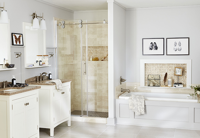 Master bathroom tub makeover with tile wall niche and paneling