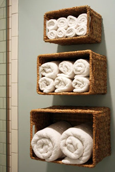 Bathroom Towel Storage Ideas: Another way to take advantage of vertical  space is by hanging baskets on the wall above the toilet or tub and using  them to