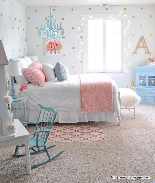 We love how the blue hanging chandelier, rocking chair and dresser all  perfectly match in this preteen girls bedroom.
