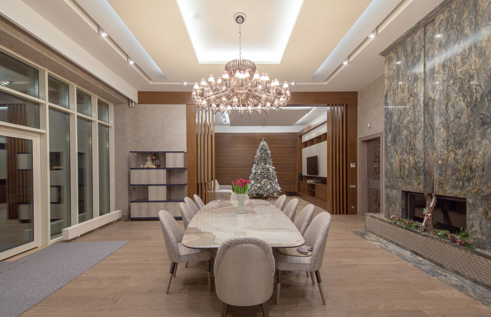 Large 10-person dining room table in large formal dining room in luxury  home.
