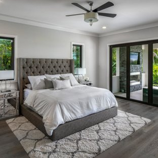 Example of a large minimalist master medium tone wood floor and gray floor  bedroom design in