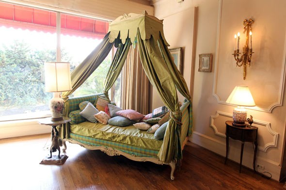 Awesome Decadent Day Bed Features A Bold Canopy And Abundant Pillows
