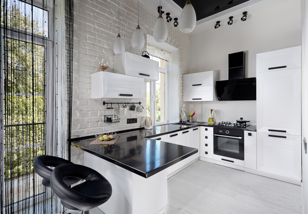 Modern black and white kitchen. I think the little bit of black is just  perfect