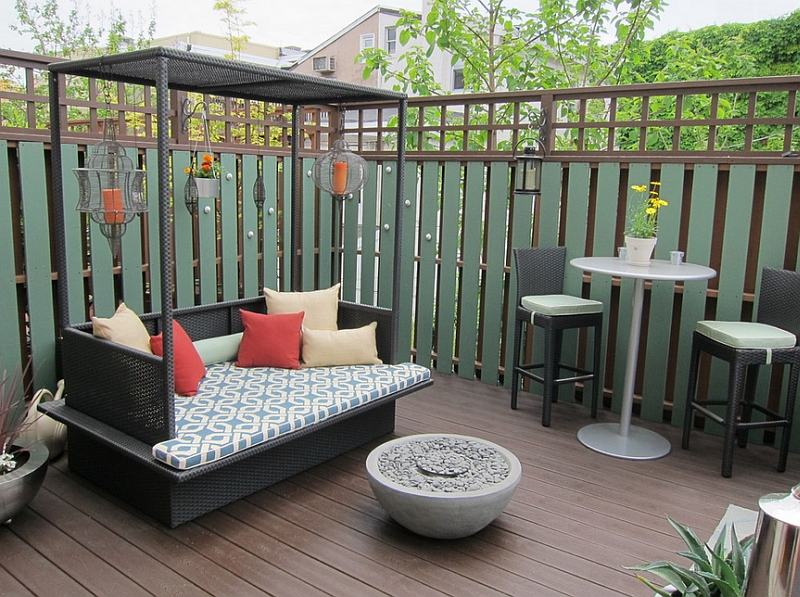 View in gallery Small outdoor bed with canopy for the compact modern deck