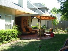 This custom patio awning creates an outdoor living room. #AwningsOfTulsa  Outdoor Living Rooms,
