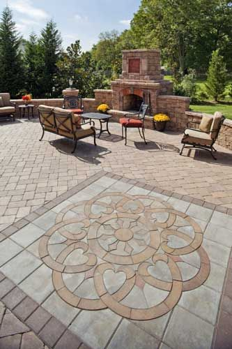 patio design ideas with pavers |  patio paver design, like artwork, can  be inserted into the patio