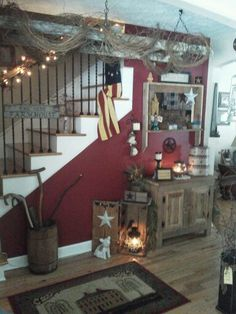 Primitive entry way with old ladder wrapped in grapevine hanging from  ceiling by Michele White mteiG. KP Creek Gifts · Primitive Decorating Ideas