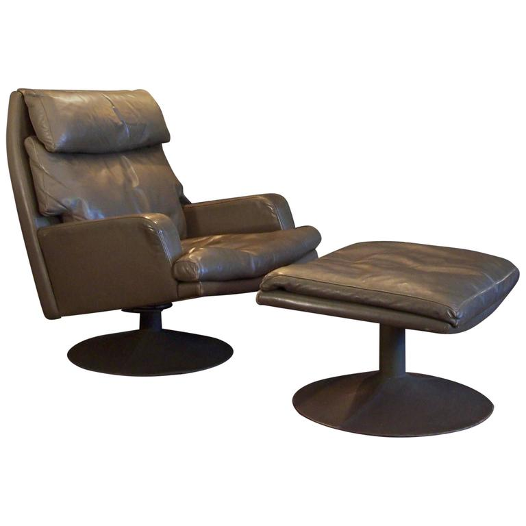 Large Vintage Leather Swivel Chair and Ottoman For Sale