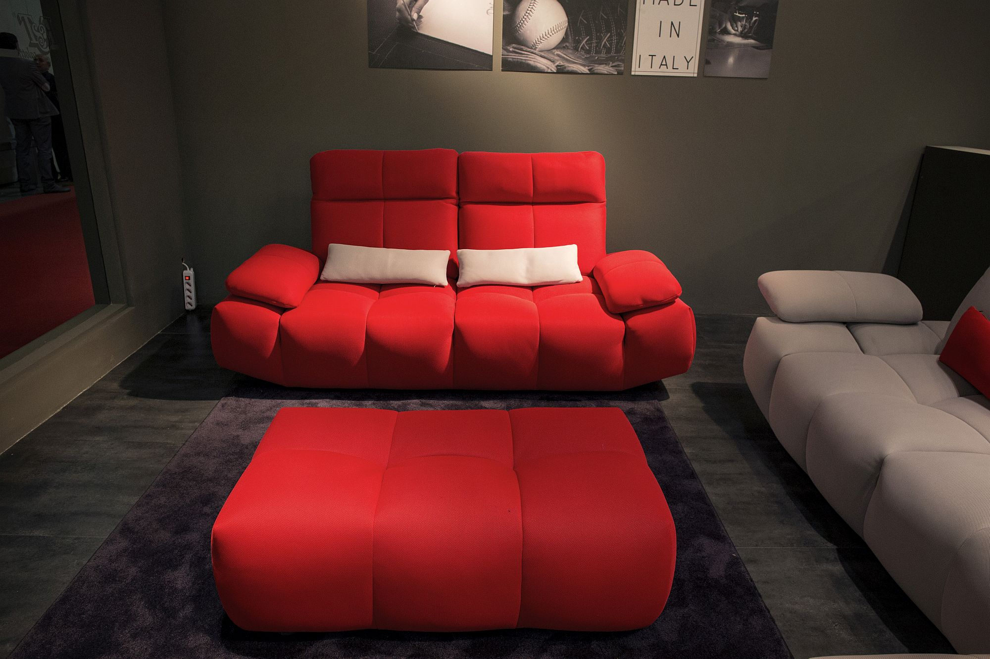Bold red sofa with modern design and a matching tufted coffee table