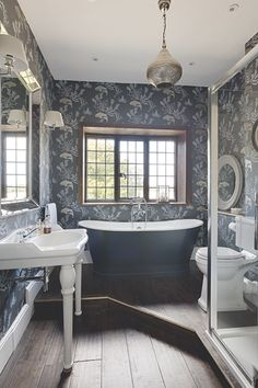 luxury bathroom with dark blue coral wallpaper and dark blue freestanding  bath Luxury Bathrooms, Country