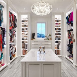 Walk-in closet - traditional gray floor walk-in closet idea in Houston with