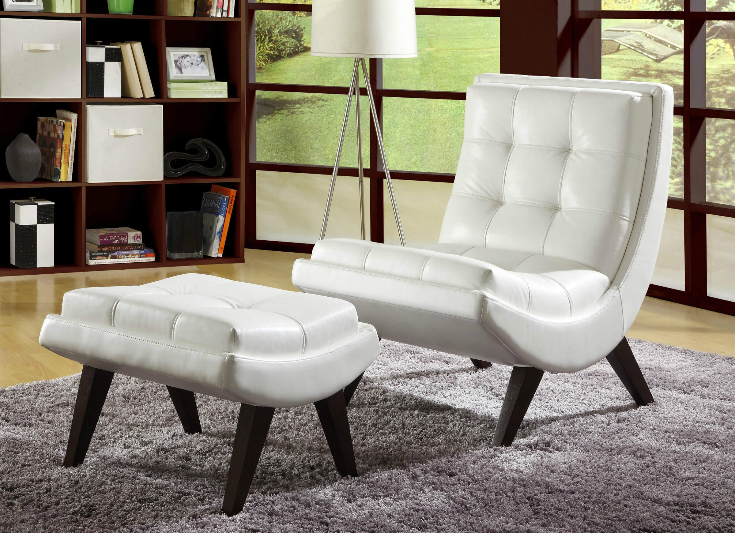 Contemporary accent chair paired with ottoman comes in white faux leather  with button tufting in curved .