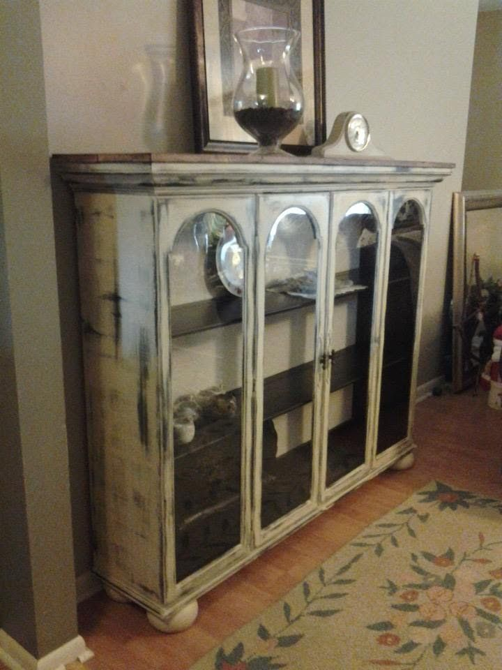 Top to a china cabinet that we repurposed. Added wood planked top, bun feet
