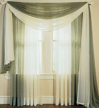 This is grey and white modern curtain design which is light in fabric. Two  extra curtains are kept over rod with the help of which downfall layer is  given