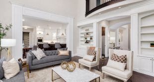 This room uses neutral tones for furnishing and adds some flair with cute  accessories. This