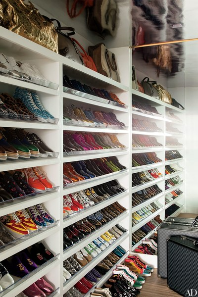 Colorful sneakers line the shoe closet of Elton John and David Furnishs Los  Angeles home.