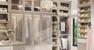 Light walk-in closet with pull-out rack closet accessories by California  Closets
