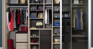 Natural Wood Stand Alone Closet with Cubbies Closet Rods Shelving Dark  Brown Accents and Sliding Glass